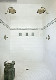Paige Sumblin Schnell - Gorgeous shower with brushed nickel rain shower heads, hex tiles floor, green mosaic tiles trim and green garden stool. Decoration Inspiration, Bathroom Inspiration, Writing Inspiration, Interior Inspiration, Small Bathroom, Master Bathroom, Master Shower, Bathroom Ideas, White Bathroom