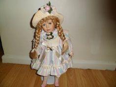 porcelain doll beautifull holding a posy bag