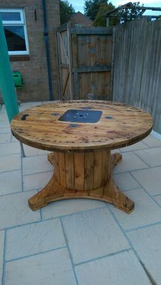 Electrical cable drum that I turned into a garden table, all thanks to ideas on pintrest!!