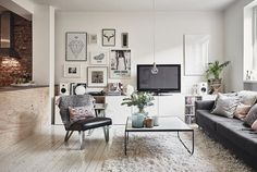 A Hygge Swedish Apartment | Coggles // Hygge (pronounced hoo-ga) is a Danish concept we can thoroughly get on board with at Coggles. Roughly translated as 'cosiness', hygge is about warmth, comfort, intimacy, and spending time with family and good friends. Hygge comes into its own in the winter months; Demark is famously cold and dark at this time of year, so Danes do what they can to make their homes as enjoyable to spend time in as possible.