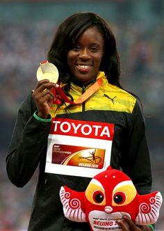 Gold medalist Danielle Williams of Jamaica poses on the podium during the medal ceremony for the Women's 100 metres final during day eight of the 15th IAAF World Athletics Championships Beijing 2015 at Beijing National Stadium
