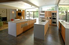 Contemporary Kitchen - Saffron Yellow Cabinets with Grey Quartz Counter Top