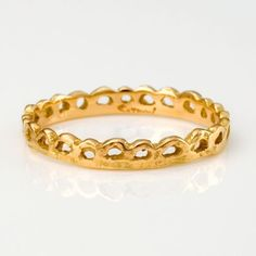 bracelet or ring, i dunno. used to hate 24k gold, but now i love the warmth and the malleability too. too bad it's hard to get outside of asia.