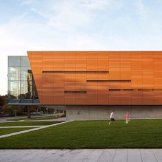 US firm Gould Evans has revamped a 1970s concrete library in Kansas wrapping the building in a terracotta rainscreen and adding modern amenities such as a recording studio. See more images on http://ift.tt/1RayTxi #architecture #library #USA by dezeen