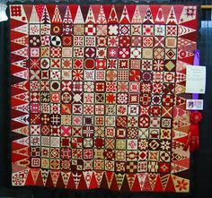 Red and white dear Jane quilt.