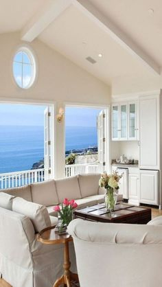 Open and airy living room with sweeping ocean views.