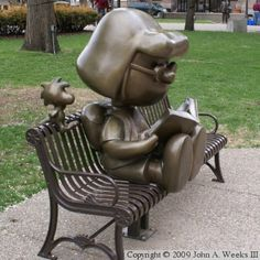 """Marcie and Woodstock - bronze statue in St. Paul, MN by artist Tivoli Too. Charles Schulz, creator of the """"Peanuts"""" characters, was born in St. Photo by John A."""