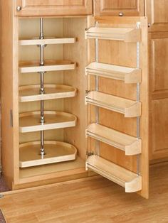 Many interesting storage solutions for kitchens - this is a small pantry solution using a turntable & storage on door. Better spice rack