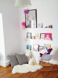 reading nooks for kiddos.. This looks exactly like Jazmin's room and now I know how to make use of that corner by her window!! READING NOOK!