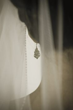 Bride's earring through veil. Delicate.