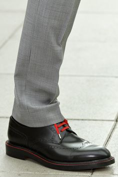 Black brogue w/ red laces..