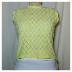 """Vintage 60s Yellow Bubble Gum Goth Punk Sweater Super cute, neon yellow and white acrylic shell top. Diamond design with 1/4 zip up back(nylon zipper) Semi-sheer, dress form has a camisole underneath. Truest color in last picture. Like new condition, only flaw is the condition of the tags, as seen in last photo. Depending on the size of your torso, this could be a crop top. Compare Measurements:  17"""" armpit to armpit, 18"""" length 7"""" arm opening. Vintage Tops"""
