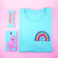 Monday survival kit with Rawbite Peanut, F*ck Average slim fit rainbow tee in mint and a quirky octopus on my phone.