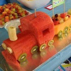 Fruit train using watermelon, kiwi,bananas, cantelope, etc. and fruit skewers