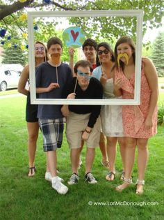 Photo booth at grad party - picture frame as a prop