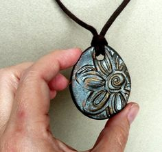Ceramic Stoneware Pendant for Necklace - Daisy Flower in Dark Metallic Grey. $ 10.75, via Etsy.