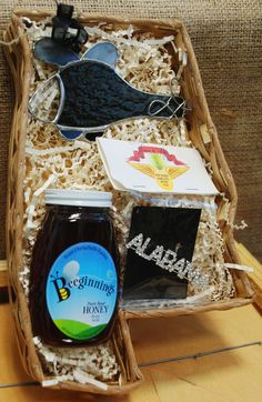 """All Things Alabama"" gift basket ($30) - includes medium Alabama-shaped basket, jar of local honey, your choice of rhinestone pin, stained glass helicopter."
