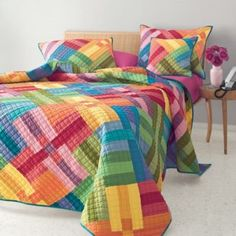 Astor Quilt Bedding. This is some bright fabulousness going on right here! I wish there was a better view. This link is kinda wonky, as there are no price or other details and I can find no better site.