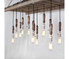Wood Pallet Chandelier  Typewriter Boneyard  Reclaimed wood from an old coca-cola pallet, this magnificent piece is sure to turn heads. Featuring 12 vintage trouble lights hung at various lengths, this pallet chandelier is the perfect piece for your flat, house, office or establishment