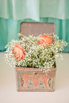 Peach flowers and baby's breath to match the bridesmaides dresses, on an ivory tablecloth...