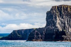 The Cliffs of Moher is situated on Ireland's Wild Atlantic Way, located on the west coast of Ireland, close to… by adam-aj West Coast Of Ireland, Cliffs Of Moher, Half Dome, Stock Photos, Mountains, Nature, Travel, Voyage, Viajes