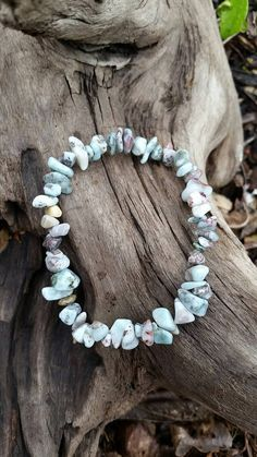 Check out this item in my Etsy shop https://www.etsy.com/listing/233872093/larimar-bracelet-natural-and-raw-stones