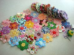 Starting to Connect the Flowers by xperimentl, via Flickr.                              Floral arrangement of hexies.