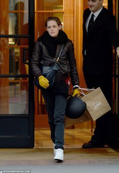 Time to shop: Kristen rocked a pair of straight-cut black jeans with a leather jacket and scarf