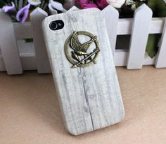 The Hunger Games Logo Bronze Mockingjay pendant white iPhone 4/4S case, Apple iPhone 4 Case, iPhone 4s Case, iPhone 4 Hard Case --- SALE. $8.99, via Etsy.