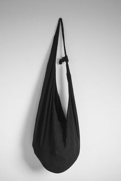 """Bags similar to this can be easily found on Ebay by searching """"black hobo thai"""" or """"black hobo crossbody"""" - they're not that expensive, and I plan on picking one up soon."""