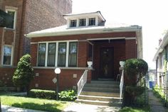 HEY !  I GOT GOOD NEWS FOR YOU! A GREAT HOME FOR ENTERTAINMENT! NOW FOR SALE ! 8328 South Maryland Avenue