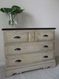 Old dresser painted a light beige and has been dry brushed with a deep brown glaze for an aged finish.