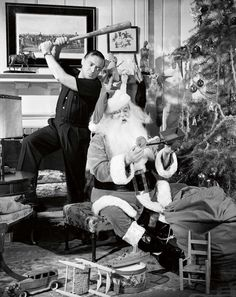 Peter Lorre takes a swing at Santa, Sydney Greenstreet, with a baseball bat, ca. 1940. Photo via John Kobal Foundation/Getty Images. °
