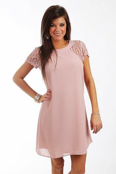 """The Anabelle Dress, Dusty Pink $41.00  This dress is absolutely beautiful! The dusty pink color is lovely, and we love the simple design with lace on the shoulders! This piece can be worn for nicer occasions or worn with boots for a casual day out.   Fits true to size. Miranda is wearing a small.   From shoulder to hem:  Small - 34""""  Medium - 34.5""""  Large - 35"""""""