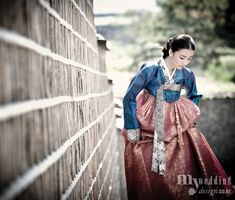 """Hanbok, Korean Traditional Dress: Hanbok (South Korea) or Chosŏn-ot (North Korea) is the traditional Korean dress. It is often characterized by vibrant colors and simple lines without pockets. Although the term literally means """"Korean clothing"""", hanbok today often refers specifically to hanbok of Joseon Dynasty and is worn as semi-formal or formal wear during traditional festivals and celebrations."""