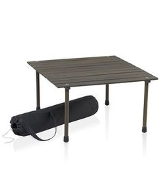 Why sit on the hard floor while dining al fresco if you can use this handy table instead? The low profile mahogany tabletop rolls up and fits into a slim and chic charcoal canvas bag. Keep it in your car with a couple of outdoor pillows this summer so you're always prepared for a spontaneous picnic.