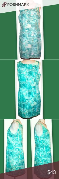 """Vintage Lilly Pulitzer Surfin Safari Shift Dress Vintage Lilly Pulitzer Surfin Safari shift dress. The cotton fabric has a jungle animal print in several shades of teal green.  White piping around neckline and armholes. Back zipper.  100% cotton   Bust 40"""" Waist 35"""" Hips 43"""" Length 35"""" Lilly Pulitzer Dresses"""