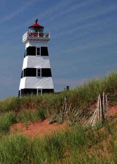 West Point Lighthouse, Prince Edward Island - I loved this lighthouse. So scenic. Prince Edward Island, Ontario, Lighthouse Lighting, Costa, Lighthouse Pictures, Atlantic Canada, Beacon Of Light, Water Tower, Anne Of Green Gables