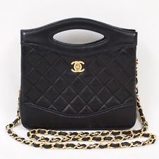 Vintage Chanel Chain Quilted Black Gold Plating Turn Lock...oh how I want a Chanel purse :(
