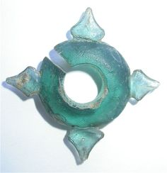 Glass ornament. Sa-Huynh culture. 2nd century BCE approximately. The Sa Huynh culture is a late prehistoric metal age society on the central coast of Viet Nam. The uncovered artifacts show the Sa Huynh people were highly skilled craftsmen in the production of jewelry and ornaments made with hard stones and glass.