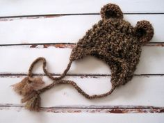 This lovely bear hat was made with chunky acrylic yarn in brown. Wonderful photography prop for babys first photo shoot. Need a baby shower or new