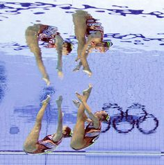 Greece's Evangelia Platanioti & Despoina Solomou in the duets final synchronised swimming competition