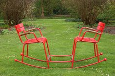 Double red rocking chairs - teeter totter for older people!