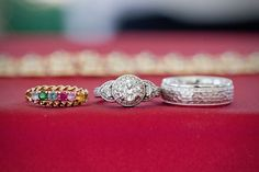 This bride honored her groom's Indian heritage by choosing a wedding band with multicolored gems. Not to be outdone, his beveled ring has great texture.Photo Credit:Erin Lindsey Images