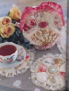 Like this pretty idea for tea cosy and coasters - can use up fabric, trim and lace scraps for this! :)