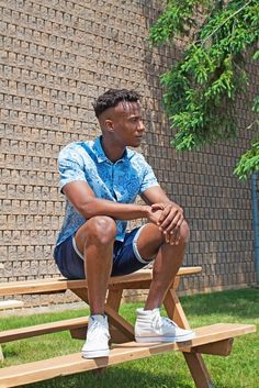 Men's casual summer outfit. Denim shorts and chambray printed button up shirt.