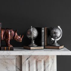 We love this quirkly pair of bookends with a silver electroplated globe sat on an aged effect faux book.  Would make an amazing gift…