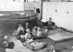 Children sit and sleep on the floor at Sisak, a Ustasa (Croatian fascist) concentration camp for children. Yugoslavia, during World War II.