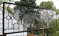 Stained Glass Window Panel--Geometric Circle Study in Clears, Textures & Bevels. $393.00, via Etsy.