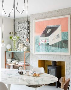 Pale Grey Dining Room with Exposed Painted Brick and Marble Table